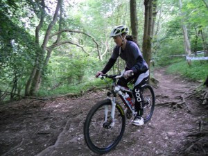Lucy riding on Bucks MTB's Skills Course on Aston Hill